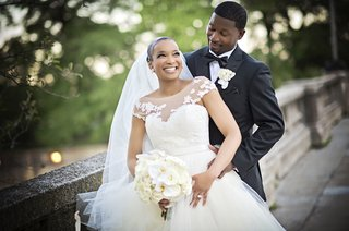 bride-in-legends-romona-keveza-gown-with-illusion-neckline-groom-in-jos-a-bank-tux