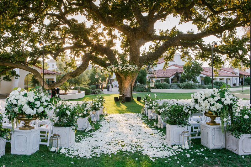 wedding ceremony aisle decorations white rose petals outdoor ceremony