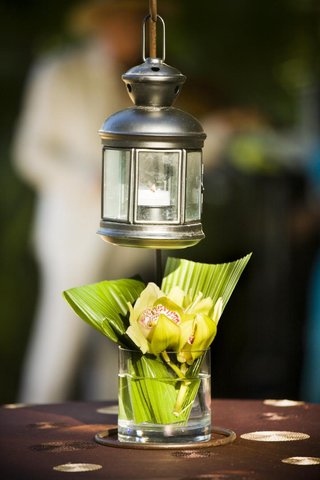 green-orchid-and-leaf-arrangement-with-silver-lantern
