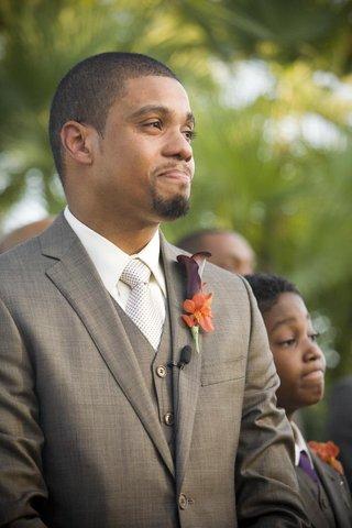 look-of-groom-as-bride-walks-down-the-aisle