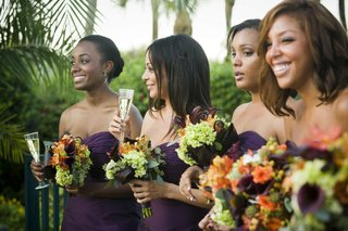 african-american-bridesmaids-holding-bouquets-and-champagne