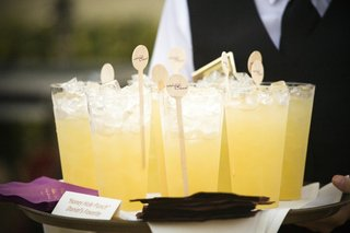 yellow-wedding-drinks-with-custom-swizzle-sticks