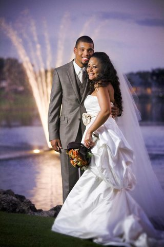 groom-in-grey-suit-with-haitian-and-lebanese-bride-at-sunset