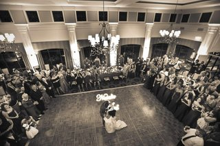 black-and-white-photo-of-couples-first-dance-in-ballroom