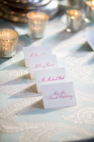 white-seating-card-with-hot-pink-calligraphy