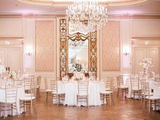 wedding reception gold chiavari chair white linen chandelier blush gold ivory centerpieces