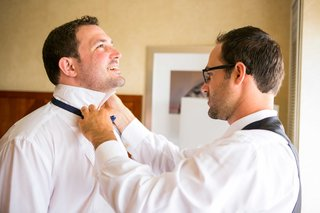best-man-helps-groom-tie-bow-tie