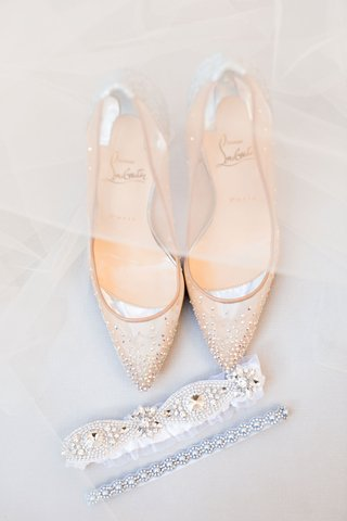 bride wedding accessories photo detail shot veil over christian louboutin heels mesh rhinestone garter