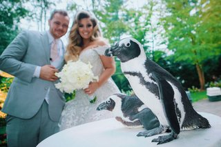 ashley-alexiss-with-husband-travis-wedding-day-penguin-at-cocktail-hour-activity