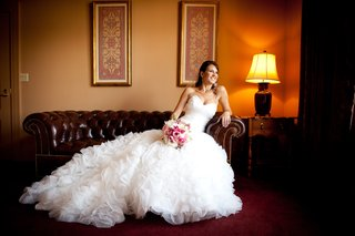bride-in-a-maggie-sottero-dress-with-ruffled-skirt-and-sweetheart-neckline-and-pink-bouquet
