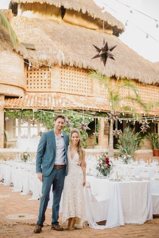bride-and-groom-at-welcome-party-rehearsal-dinner-destination-wedding-in-mexico-thatched-roof