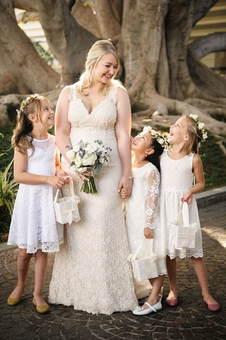 bride-in-lace-wedding-dress-with-three-flower-girls-flower-crowns-and-lace-knee-length-dresses