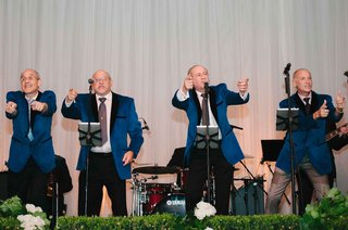 blue-motown-inspired-blazers-on-father-of-bride-and-her-uncles-for-surprise-wedding-reception-song