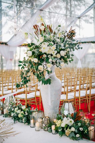 wedding-ceremony-red-carpet-gold-chairs-white-aisle-runner-greenery-white-flowers-candles
