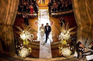 wedding-ceremony-birds-eye-view-white-aisle-runner-flower-petals-gold-palm-leaves-white-hydrangea