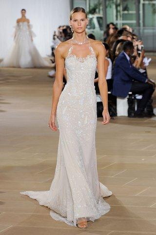 ines-di-santo-fall-2019-bridal-collection-wedding-dress-kaia-halter-neckline-low-back-beading