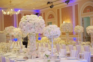 joanna-krupa-wedding-reception-with-white-flower-centerpieces