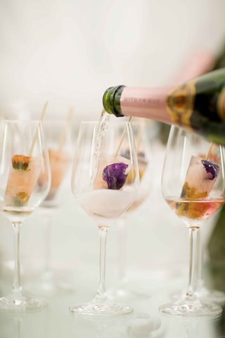 pink-champagne-poured-over-gourmet-flower-popsicles