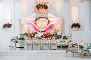 reception-tablescape-pink-purple-blue-gold-wings-white-lounge-area