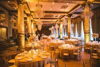 wedding-reception-the-drake-hotel-chicago-tall-columns-round-table-gold-chair-tall-centerpiece