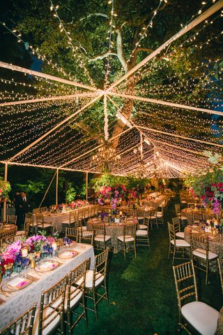 gold-and-white-wedding-linens-with-purple-pink-and-red-flower-centerpieces