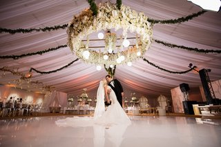large-orchid-chandelier-with-round-lights-hanging-down-and-garlands-extending-outward