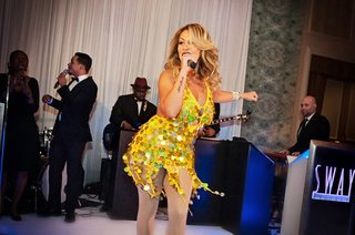 jenilca-giusti-sings-at-friends-wedding-in-gold-sequin-dress