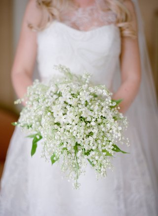bride-in-wedding-dress-by-romona-keveza-wedding-gown-lily-of-the-vallery-and-bluebell-bouquet-green
