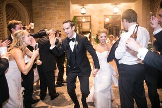 newlyweds-exit-venue-as-guests-smile-and-cheer
