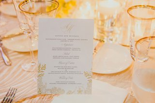 wedding-menu-card-with-gold-coral-details-and-monogram-for-destination-wedding