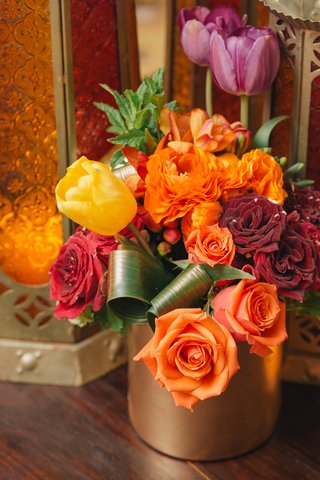 orange-roses-and-yellow-tulips-in-gold-vessel