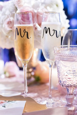 wedding-reception-table-sweetheart-table-with-mr-and-mrs-calligraphy-gold-rim-champagne-flutes-glass
