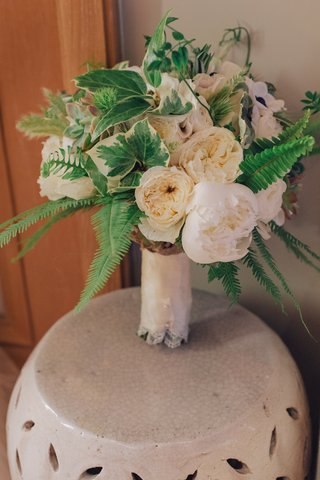 white-and-green-flowers-tied-with-lace-on-ceramic-drum