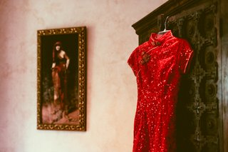 red-silk-outfit-with-sequins-hanging-on-cabinet