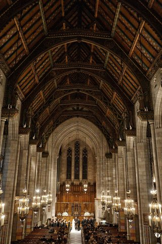 traditional-wedding-ceremony-at-church-in-chicago-high-ceilings-stained-glass-windows-chandeliers