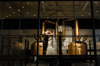 bride-and-groom-alone-in-whiskey-distillery