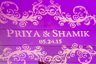 purple-light-projection-with-bride-and-grooms-name-and-wedding-date