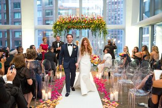 wedding-ceremony-in-new-york-city-white-aisle-runner-with-pink-and-orange-yellow-flower-petals