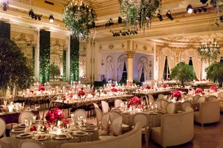wedding-reception-ballroom-hedge-wall-greenery-chandelier-round-rectangle-tables-pink-red-flowers