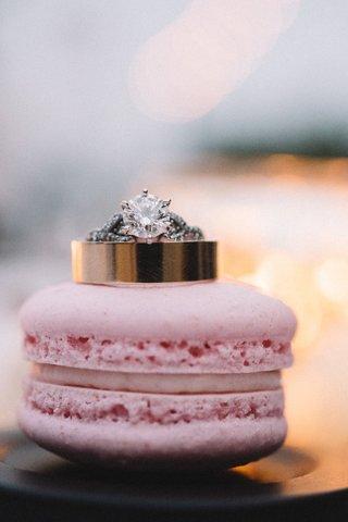 wedding-rings-on-pink-french-macaron