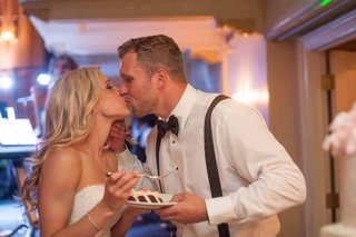 brian-leonard-running-back-in-tuxedo-shirt-suspenders-bow-tie-kisses-bride-in-isabelle-armstrong
