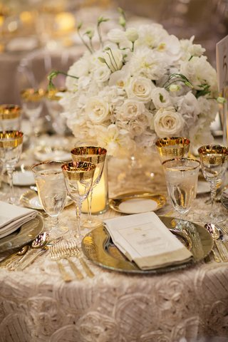 textured-champagne-linens-gold-rimmed-goblets-white-roses-orchids