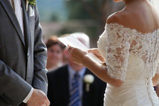 woman-holding-handwritten-paper-note-in-wedding-dress