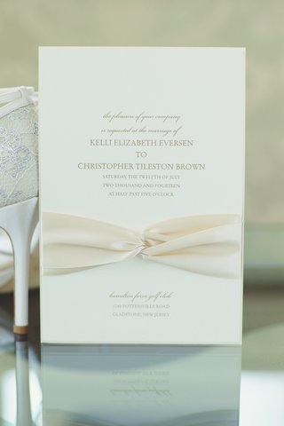 simple-invite-with-ivory-ribbon-and-gold-lettering