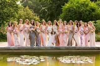garden-wedding-with-fifteen-bridesmaids-in-different-dresses