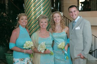 bride-in-light-blue-dress-and-family
