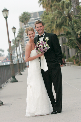 bride-and-groom-smile-near-docks-in-california