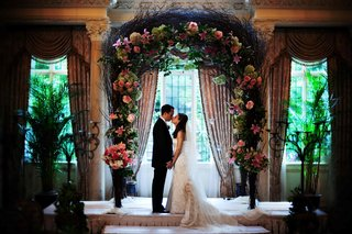 wedding-chuppah-with-dark-branches-and-stargazer-lilies