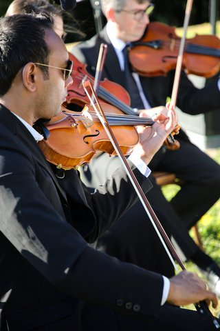 trio-of-string-musicians-performing-at-wedding-ceremony