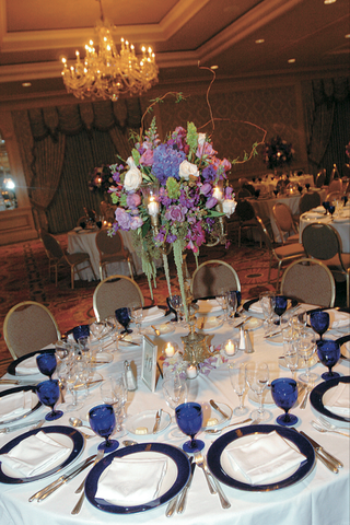 white-table-with-blue-glassware-and-purple-centerpiece